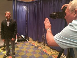 Les Stone photographs San Fransisco Telemundo reporter Andres Brender on Friday. Free professional photos are available for EIJ attendees throughout the weekend in the J-Expo center.