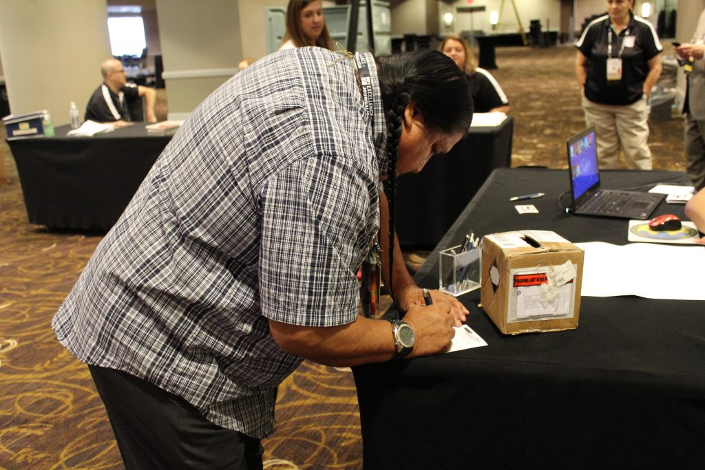 Yakama Nation's Roy Dick casting his ballot for the 2016 NAJA election.